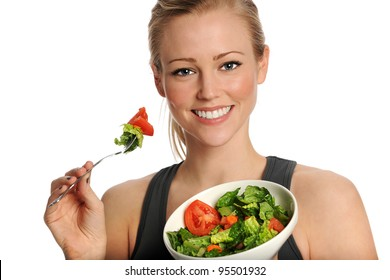 Healthy young woman eating salad