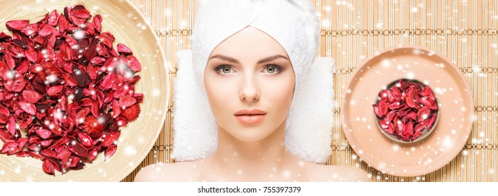 Healthy young woman getting health care treatments in massaging salon. Winter and Christmas spa concept.