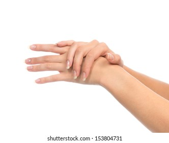 Healthy young woman hands with french manicure nails isolated on a white background