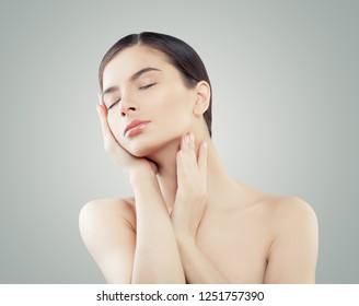 Healthy young woman with perfect skin. Facial treatment, wellness and spa concept