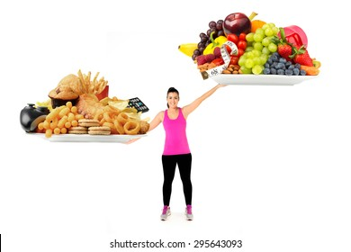 Healthy Young Woman with plates of healthy and unhealthy food and lifestyle as balance weigh scales healthy food wins