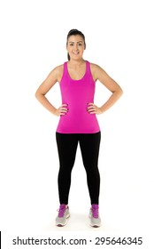 Healthy Young Woman standing hands on hips in gym kit