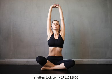 healty woman doing yoga or sport in industrial apartment or gym