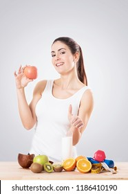 Healty young woman eating an apple. Healthy food concept.