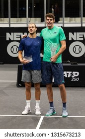 Heampstead, NY - February 17, 2019: Winner Reilly Opelka of USA and Brayden Schnur of Canada pose with trophies after final of New York Open ATP 250 tournament at Nassau Coliseum