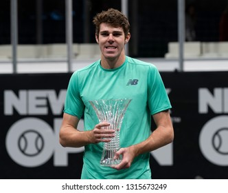 Heampstead, NY - February 17, 2019: Reilly Opelka of USA holds winner trophy after defeating Brayden Schnur of Canada at final of New York Open ATP 250 tournament at Nassau Coliseum