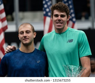 Heampstead, NY - February 17, 2019: Winner Reilly Opelka of USA and Brayden Schnur of Canada pose during trophy presentation after final of New York Open ATP 250 tournament at Nassau Coliseum