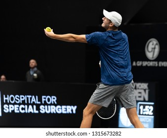 Heampstead, NY - February 17, 2019: Brayden Schnur of Canada serves during final of New York Open ATP 250 tournament against Reilly Opelka of USA at Nassau Coliseum