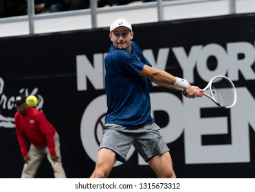 Heampstead, NY - February 17, 2019: Brayden Schnur of Canada returns ball during final of New York Open ATP 250 tournament against Reilly Opelka of USA at Nassau Coliseum