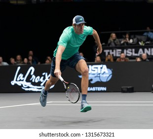 Heampstead, NY - February 17, 2019: Reilly Opelka of USA chases ball during final of New York Open ATP 250 tournament against Brayden Schnur of Canada at Nassau Coliseum