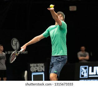 Heampstead, NY - February 17, 2019: Reilly Opelka of USA serves during final of New York Open ATP 250 tournament against Brayden Schnur of Canada at Nassau Coliseum
