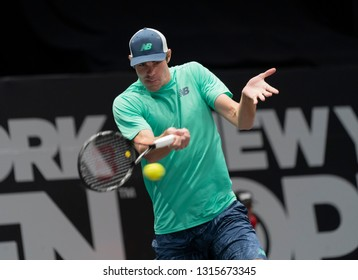 Heampstead, NY - February 17, 2019: Reilly Opelka of USA returns ball during final of New York Open ATP 250 tournament against Brayden Schnur of Canada at Nassau Coliseum