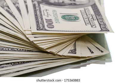 Heap of $100 dollar bills on white background