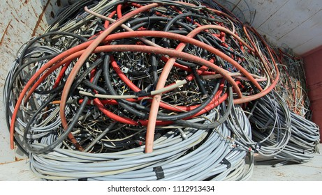 heap of abandoned electric wires in the big container