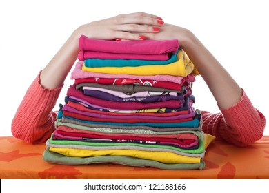 Heap of arranged colorful clothes, isolated