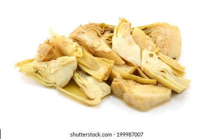 Heap of artichoke heart slices in olive oil and herbs, isolated on a white background