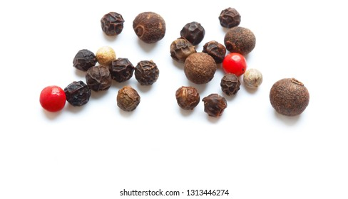 heap of assorted peppercorns isolated on white background