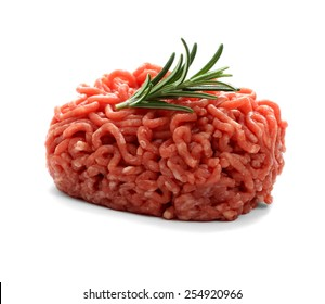 heap beef minced meat with rosemary, isolated
