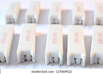 A heap of big ceramic white power resistors with 120 Ohm resistance and 5 Watt power dissipation, with vertical radial through hole mount, with pins