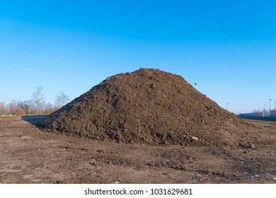 heap of black sand on a construction site