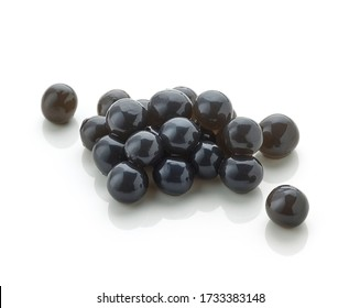 Heap of black tapioca pearls for bubble tea isolated on white background