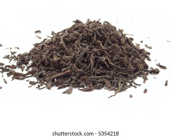 heap of black tea. isolated on white background
