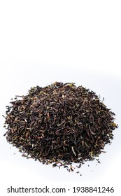 Heap of black tea on a white background. Dry black tea leaves isolated on white background, delicious, natural. Flat lay.