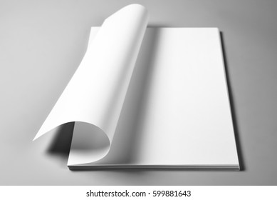 Heap of blank sheets of paper with curled upper page, selective focus