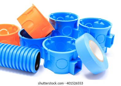 Heap of blue and orange electrical boxes with components for use in electrical installations, accessories for engineering jobs