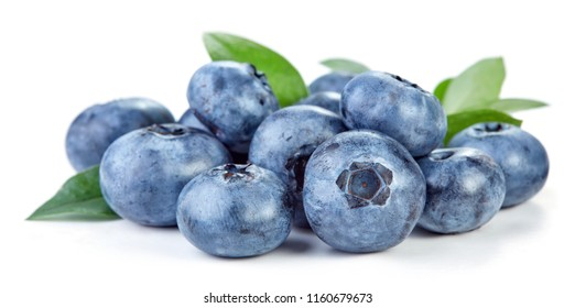 heap of blueberry fruits with green leaves isolated on white background