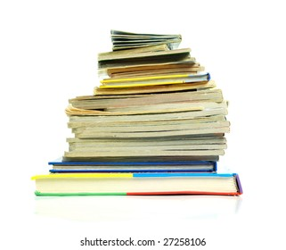Heap of books of the different sizes on a white background