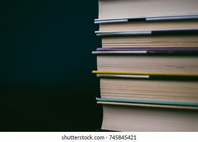 Heap of books on the cork board. Closeup of pages. Abstract concept of knowledge, education, learning, and literature. Black and white
