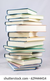 Heap of books on a white isolated background with a nib