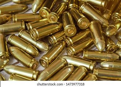 Heap of brass gun bullets closeup