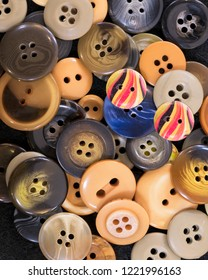 Heap of buttons in a variety of colors and sizes