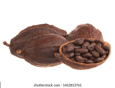 heap of cacao pods with cacao beans isolated on white