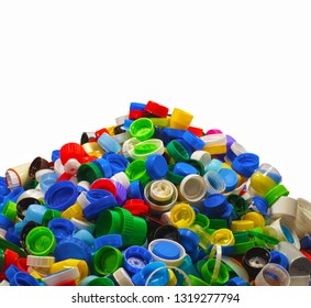 Heap of caps from plastic bottles. Secondary raw material, most often it is HDPE (High-density polyethylene).