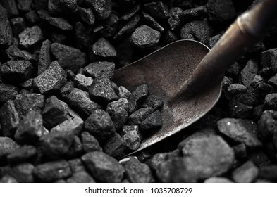 Heap of carbon with shovel