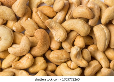 Heap of cashew nut on white background in studio