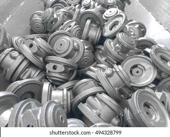 Heap of casting automotive parts cleaning in factory