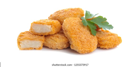 a heap of chicken nuggets with a parsley leaf on a white isolated background