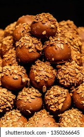Heap of chokolate cakes with nuts