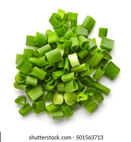 Heap of chopped spring onions isolated on white background, top view