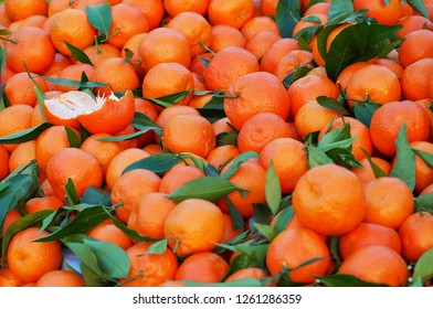 Heap of  clementines, a hybrid between mandarin and sweet orange,just picked. Food background.