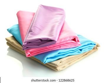 heap of cloth fabrics isolated on white