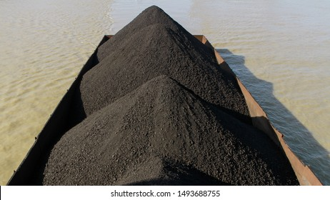 heap of coal in the barges