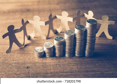 Heap coins stair with human chain paper for success teamwork concept