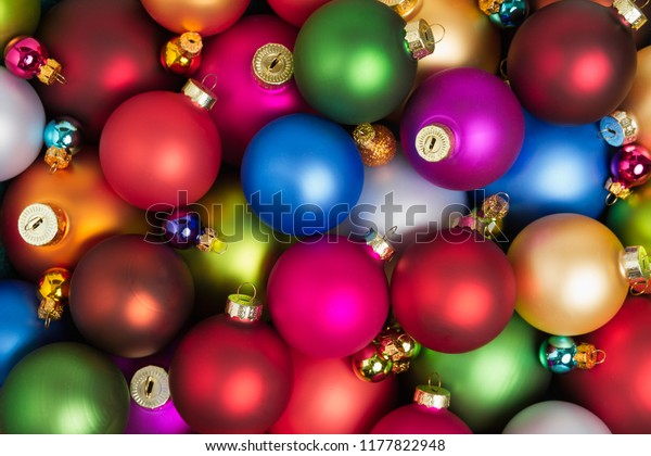 A heap of colorful christmas baubles lying on the floor.
