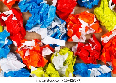 Heap of colorful crumpled wrapping papers , background