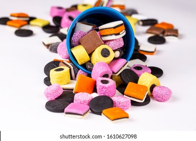 Heap of colorful Liquorice allsorts isolated on white background